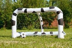 Раздувной футбольный мяч и цель Стоковое фото RF