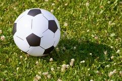 Раздувной футбольный мяч ребенка Стоковые Фотографии RF