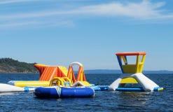 Раздувные привлекательности aquapark в воде Стоковое фото RF