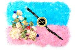 Раковины и компас моря на голубом розовом соли Стоковые Изображения