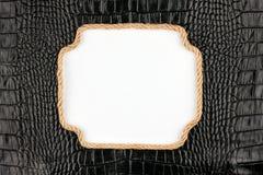 Рамка веревочки, лож на предпосылке черноты Стоковое Фото