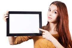 Рамка владением девушки пустая Стоковые Изображения