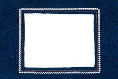 Рамка джинсовой ткани с темными джинсами с серебряными стразами Стоковая Фотография