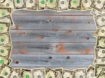 Рамка от долларов на деревянной доске Стоковая Фотография RF