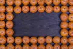 Рамка плодоовощ мандарина Концепция здоровой, органическая, еда vegan, витамины Взгляд сверху Свежий апельсин, предпосылка tanger Стоковое фото RF