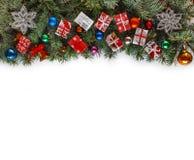 Рамка рождества с ветвями рождества и оформление рождества изолированное на белизне Стоковая Фотография RF