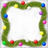 Рамка рождества ели разветвляет украшенные гирляндой шарики цвета Стоковая Фотография RF