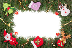 Рамка рождества сделанная ветвей ели украшенных при изолированные снеговик и Санта Клаус на белой предпосылке Стоковое фото RF