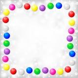 Рамка рождества шариков цвета на предпосылке серого цвета нерезкости Стоковая Фотография RF