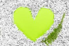 Рамка сердца сделанная из shredded бумаги и зеленых лист Стоковое Изображение RF