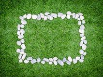 Рамка с предпосылкой травы камней Стоковые Фото