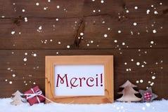 Рамка с украшением рождества, снежинкой, серединой Merci спасибо Стоковая Фотография RF