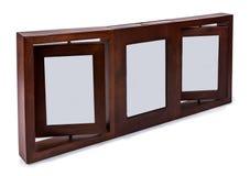 Рамка фото Брайна деревянная установила кадр 3 вращанный в плоскости изолированное  Стоковые Фото