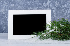 Рамка фото за ветвью рождественских елок Стоковые Фотографии RF