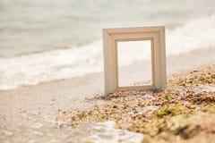 Рамка фото на пляже песка Стоковое Изображение