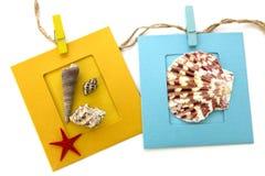 Рамка фото с белизной seashell стоковое изображение