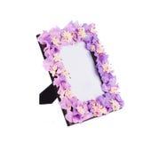 Рамка фото с искусственными цветками Стоковое Изображение RF