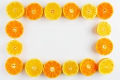 рамка tangerines на белой предпосылке Стоковые Изображения RF