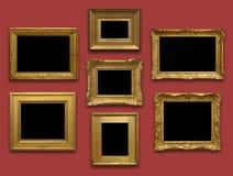 Рамки золота стены галереи Стоковое фото RF