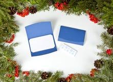 Рамки рождества с вечнозеленой елью, конусами, ягодой падуба Стоковые Изображения