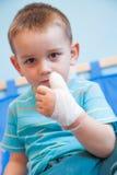 Раненный в левой руке Стоковые Фото