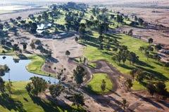 Рано утром свет на поле для гольфа Стоковое Фото