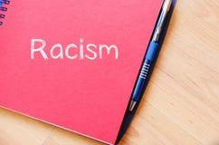 Расизм пишет на тетради Стоковая Фотография