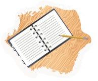 Раскройте блокнот и карандаш на таблице Стоковые Изображения