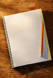Раскройте тетрадь на таблице и карандаше Стоковое фото RF