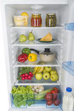 Раскройте холодильник вполне свежих фруктов и овощей Стоковая Фотография