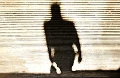 Расплывчатая тень идти человека стоковые фото