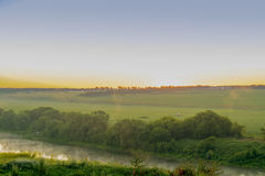 Рассвет рекой в сельской местности Стоковые Фото