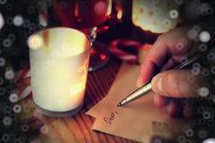 Рассказ сочинительства руки рождества Стоковая Фотография