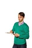 Рассогласование удивленное бизнесменом в контрольном списоке Стоковые Фотографии RF