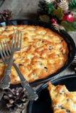 Расстегай от яичек на таблице украшенной с сосенкой c Стоковое Изображение