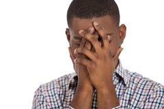 Расстроенный человек совершенно покрывая его сторону стоковое фото
