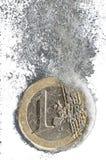 растворяя евро Стоковая Фотография