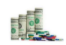 Растущая столбчатая диаграмма от азартной игры банкнот доллара США Стоковое Фото