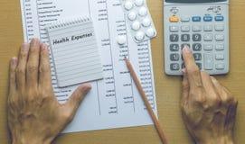 Расходы здоровья планирования человека Стоковые Фотографии RF