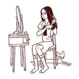 расчесывающ волос девушки она Стоковая Фотография