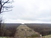 Расчистка в лесе для газопровода Стоковое фото RF