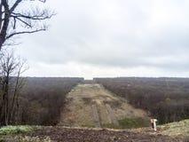Расчистка в лесе для газопровода Стоковые Изображения RF