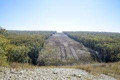 Расчистка в лесе для газопровода Стоковое Изображение RF