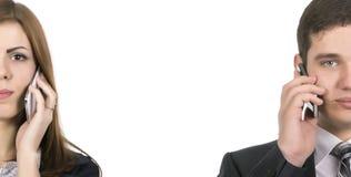 Радиосвязи бизнесмены человека и женщины Стоковые Фото