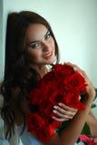 Радостная девушка с цветками Стоковые Фотографии RF