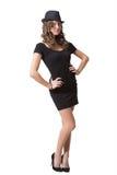 Радостная милая девушка нося черные платье и классику Стоковые Фото