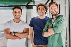 Радостные мужские коллеги горды их работы Стоковое Фото