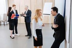 Радостные приятные коллеги говоря друг с другом Стоковое Изображение