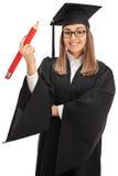 Радостный аспирант держа большой карандаш стоковая фотография rf