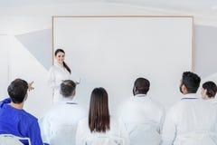 Радостный домашний врач имея переговор с коллегами Стоковые Изображения RF